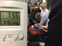 Long Journey How Commuters Cope by Commuters To Face Journey Home On London Transport Metro News