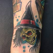 seasonally ghoulish and creative halloween tattoos