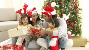 family opening christmas gifts at home footage in high definition