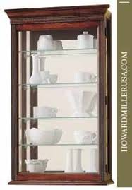 wall mounted curio cabinet 685104 howard miller wall mounted curio display cabinet windsor cherry
