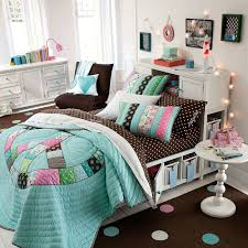 bedroom quilt bedding and accent chair with white cabinet also