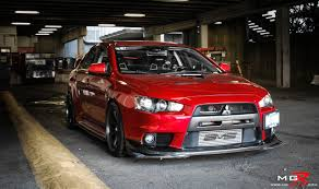 mitsubishi evo red and black mitsubishi lancer evolution a car that can dominate just about