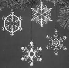 1977 metal snowflakes collection set of 4 mibnt hallmark ornament