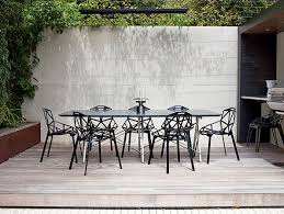 unique of iron outdoor furniture in back porch on wooden flooring
