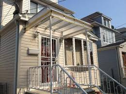 Home Awning Metal And Glass Home Awnings Making A Comeback In The Queens And