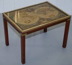 stunning nest of three campaign side tables with brass mounts