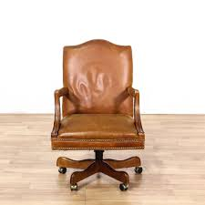 this office chair is featured in a buttery soft brown leather