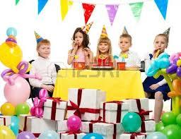 croup of happy children celebrating birthday table stock
