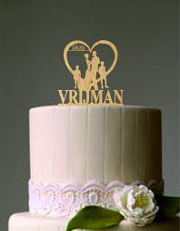 family wedding cake toppers family wedding cake topper and groom with two boy