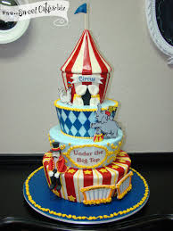 4 tier circus themed cake complete with a tent an elephant seal