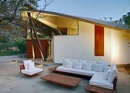 indoor outdoor home in india sheltered by concrete leaves