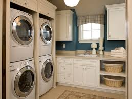 White Laundry Room Cabinets by Sophisticated Hidden Laundry Room And Closet With Wooden Cabinet