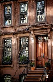 brownstone home with great windows and door way style new york