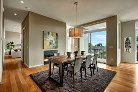 contemporary dining room with pendant light by debbie jungquist