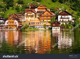 wooden houses hallstatt austria reflections lake stock photo