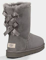 ugg bailey bow black friday sale kid s bailey bow in the color grey by ugg enhances the defining