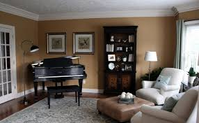 black piano body beside comfortable couch right for piano