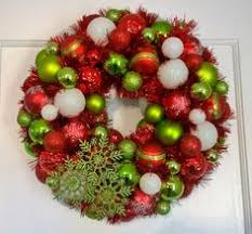 homemade christmas wreath made out of plastic ornaments from
