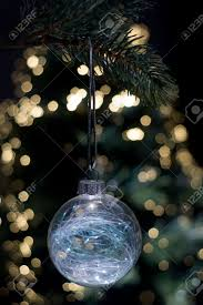 Hanging Tree Lights by Clear Glass Christmas Ornament Hanging From A Tree With A