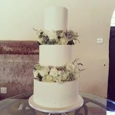 three tier wedding cake with fresh flower tiers