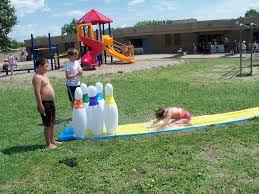 life size bowling with inflatable bowling pins and slip n slide
