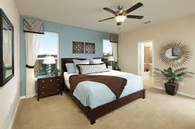 small bedroom with pleasant master bed using light blue bedding