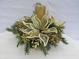 gold and cream poinsettia centerpiece in a brass pot