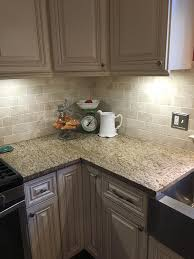 how pair countertop colors with dark cabinets kitchen new traventine back splash giallo ornamental granite complement white mushroom cabinets