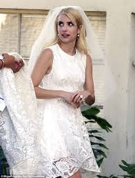 emma roberts spotted wearing white lace wedding dress on set of