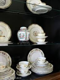 how to arrange dishes in china cabinet how to style a china cabinet thistle key