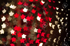 abstract star shaped bokeh background of red and white christmas
