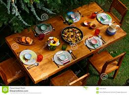 spanish style dining table with paella overview stock photo