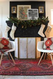 wonderful black stacked stone fireplace with christmas decoration