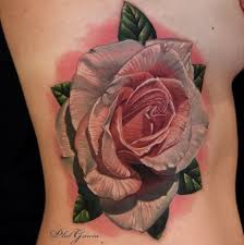 realistic looking colored side tattoo of big rose with leaves