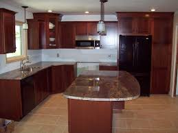 kitchen medium cherry wooden cabinet with silver appliances and