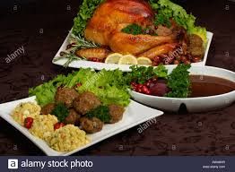 thanksgiving day dinner plate with turkey on the table in usa stock