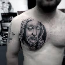 5 christian tattoos on chest for men