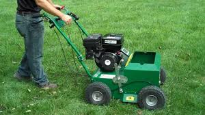 Walk Behind Seed Planter by One Stop Rental Using An Overseeder Youtube