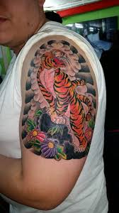 japanese tiger on left arm yelp
