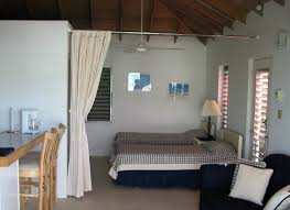 using curtain room dividers in home trendslidingdoors throughout