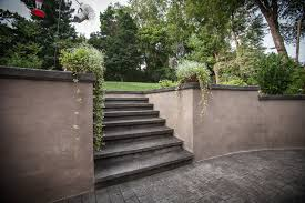 backyard stamped concrete and wall spray into retreat surecrete