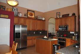 Orange Accent Wall by Red Accent Wall In Kitchen With Brown Cabinets Google Search