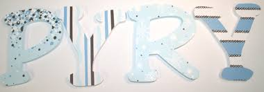 blue and white hanging wood wall letters