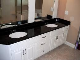 BLACK GALAXY Granite Colors For White Cabinets - Black granite with white cabinets in bathroom