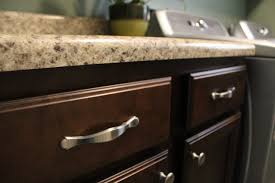 kitchen cabinets knobs or handles handles on cabinet drawers and knobs on cabinet doors silver