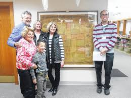 irons family presents historical map to library morrow county