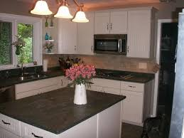 enamour subway tile in kitchen with concrete countertops and stove