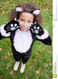 cat costume for halloween young outdoors in cat costume on halloween stock photos