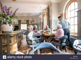 a group of retired people having lunch at the painswick near