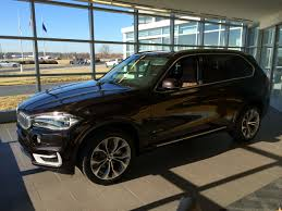bmw x5 inside performance center delivery of sparking brown terra xdrive35i